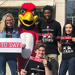 Rufus the RedHawk with students