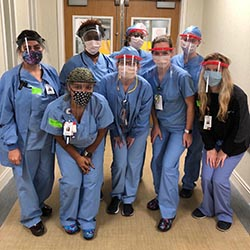 healthcare workers with face shields